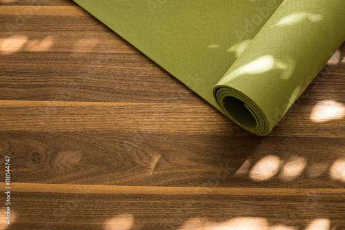aec0972ea0ecb Door Murals Yoga mat on a wooden background. Equipment for yoga ...