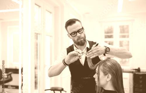 Wall Murals Handsome Hairdresser Cutting Customer Hair